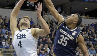 Notre Dame forward Bonzie Colson (35) blocks a shot by Pittsburgh forward Ryan Luther (4) during the first half of an NCAA college basketball game, Saturday, Dec. 31, 2016, in Pittsburgh. (AP Photo/Fred Vuich)