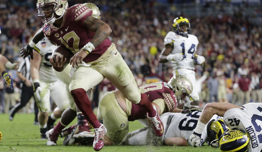 Florida State quarterback Deondre Francois (12) scores a touchdown during the second half of the Orange Bowl NCAA college football game against Michigan, Friday, Dec. 30, 2016, in Miami Gardens, Fla. (AP Photo/Alan Diaz)
