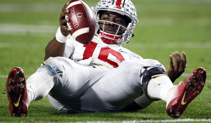 Ohio State quarterback J.T. Barrett looks to the sideline bench after being sacked bu Clemson during the second half of the Fiesta Bowl NCAA college football playoff semifinal, Saturday, Dec. 31, 2016, in Glendale, Ariz. (AP Photo/Ross D. Franklin)