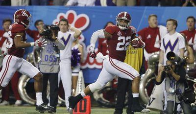 Alabama linebacker Ryan Anderson (22) returns an interception for a touchdown during the first half of the Peach Bowl NCAA college football playoff game against Washington, Saturday, Dec. 31, 2016, in Atlanta.(AP Photo/John Bazemore)