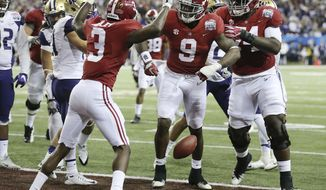 Alabama running back Bo Scarbrough (9) celebrates his touchdown run with teammates Calvin Ridley (left) and Cam Robinson Washduring the first quarter of the Peach Bowl NCAA college football playoff game against Washington, Saturday, Dec. 31, 2016, in Atlanta. (Curtis Compton/Atlanta Journal-Constitution via AP)