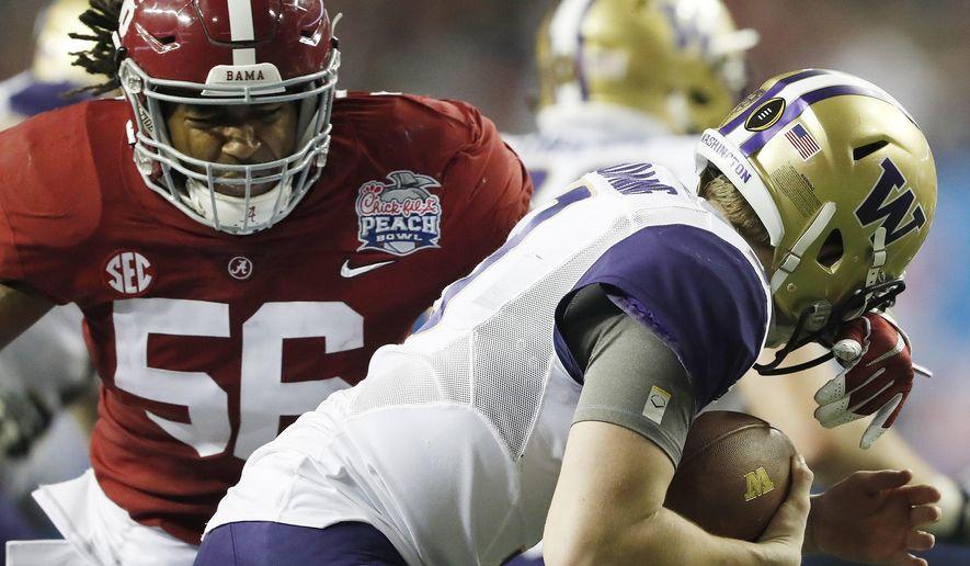Alabama linebacker Tim Williams (56) sacks Washington quarterback Jake Browning (3) during the second half of the Peach Bowl NCAA college football playoff game, Saturday, Dec. 31, 2016, in Atlanta. (AP Photo/John Bazemore)
