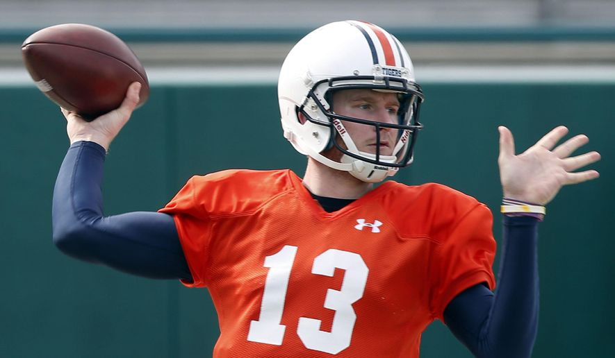 Auburn quarterback Sean White (13) throws during practice in New Orleans, Thursday, Dec. 29, 2016, for the Sugar Bowl NCAA college football game, which will be played Jan. 2, 2017 against Oklahoma. (AP Photo/Gerald Herbert)