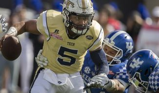 Georgia Tech quarterback Justin Thomas (5) runs the ball against during the first half of the TaxSlayer Bowl NCAA college football game against Kentucky, Saturday, Dec. 31, 2016, in Jacksonville, Fla. (AP Photo/Stephen B. Morton)