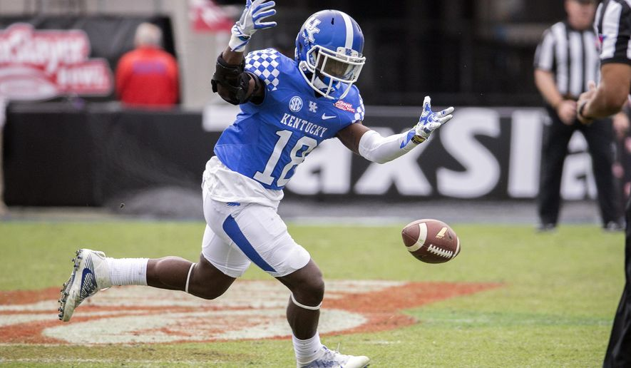 Kentucky running back Stanley Williams (18) drops a pass during the second half of the TaxSlayer Bowl NCAA college football game against Georgia Tech, Saturday, Dec. 31, 2016, in Jacksonville, Fla. Georgia Tech beat Kentucky 33-18. (AP Photo/Stephen B. Morton)