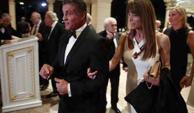 Actor Sylvester Stallone, left, and his wife Jennifer Flavin arrive for a New Years Eve party at Mar-a-Lago attended by President-elect Donald Trump, Saturday, Dec. 31, 2016, in Palm Beach, Fla. (AP Photo/Evan Vucci)