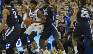 Creighton center Justin Patton (23) backs up into Villanova forward Eric Paschall (4) to make a shot during the first half of an NCAA college basketball game in Omaha, Neb., Saturday, Dec. 31, 2016. (AP Photo/John Peterson)