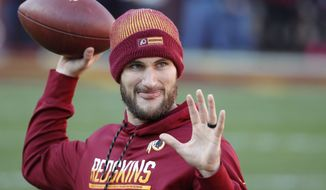 Washington Redskins quarterback Kirk Cousins (8) warms up before an NFL football game against the New York Giants in Landover, Md., Sunday, Jan. 1, 2017. (AP Photo/Alex Brandon)
