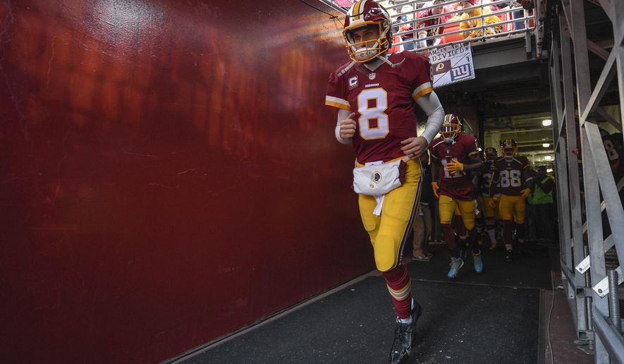 Washington Redskins quarterback Kirk Cousins (8) runs onto the field before an NFL football game against the New York Giants in Landover, Md., Sunday, Jan. 1, 2017. (AP Photo/Nick Wass)