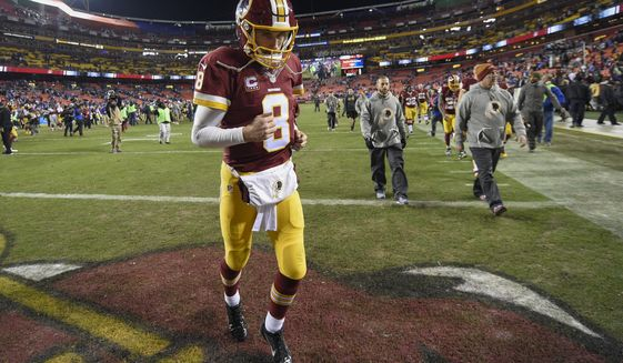 Washington Redskins quarterback Kirk Cousins (8) runs off the field after an NFL football game against the New York Giants in Landover, Md., Sunday, Jan. 1, 2017. The New York Giants defeated the Washington Redskins 19-10. (AP Photo/Nick Wass)
