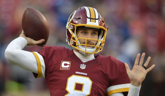 Washington Redskins quarterback Kirk Cousins (8) warms up before an NFL football game against the New York Giants in Landover, Md., Sunday, Jan. 1, 2017. (AP Photo/Nick Wass)