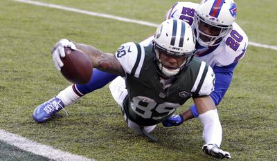 New York Jets wide receiver Jalin Marshall (89) dives in for a touchdown as Buffalo Bills free safety Corey Graham (20) defends during the second half of an NFL football game, Sunday, Jan. 1, 2017, in East Rutherford, N.J. (AP Photo/Seth Wenig)