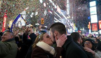 Kaitlin Olivi of Yonkers, N.Y., and Lucas Pereira, of Sayreville, N.J., kiss as confetti falls during a celebration of the new year in New York's Times Square, Sunday, Jan. 1, 2017. (AP Photo/Craig Ruttle)
