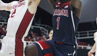 Arizona's Rawle Alkins (1) shoots as Stanford's Robert Cartwright defends during the first half of an NCAA college basketball game, Sunday, Jan. 1, 2017, in Stanford, Calif. (AP Photo/George Nikitin)