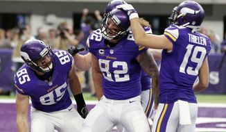 Minnesota Vikings tight end Kyle Rudolph (82) celebrates with teammates after catching a 22-yard touchdown pass during the first half of an NFL football game against the Chicago Bears, Sunday, Jan. 1, 2017, in Minneapolis. (AP Photo/Jim Mone)