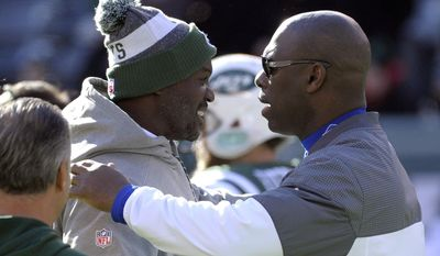 New York Jets head coach Todd Bowles, left, talks to Buffalo Bills interim coach Anthony Lynn prior to an NFL football game, Sunday, Jan. 1, 2017, in East Rutherford, N.J. (AP Photo/Bill Kostroun)
