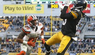 Pittsburgh Steelers wide receiver Cobi Hamilton (83) makes the winning touchdown catch during overtime of an NFL football game with Cleveland Browns strong safety Briean Boddy-Calhoun (20) defending in Pittsburgh, Sunday, Jan. 1, 2017. (AP Photo/Jared Wickerham)