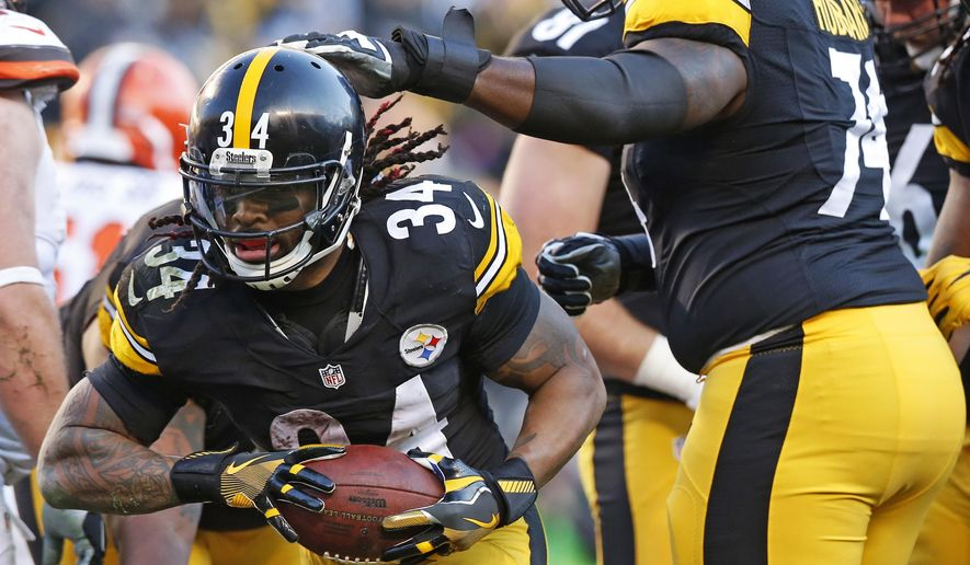 Pittsburgh Steelers running back DeAngelo Williams (34) celebrates his touchdown with offensive tackle Chris Hubbard (74) during the second half of an NFL football game against the Cleveland Browns in Pittsburgh, Sunday, Jan. 1, 2017. (AP Photo/Jared Wickerham)