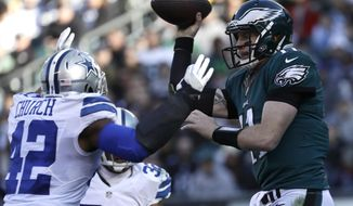 Philadelphia Eagles' Carson Wentz passes against Dallas Cowboys' Barry Church during the first half of an NFL football game Sunday, Jan. 1, 2017, in Philadelphia. (AP Photo/Michael Perez)