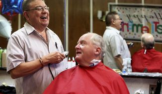 ADVANCE FOR WEEKEND EDITIONS - In this photo taken Wednesday, Dec. 21, 2016, Rick Klein gives a haircut to Jerry Koppes, of Dubuque, Iowa, at Link's Barber Shop in Dubuque. Klein is retiring after 53 years. (Jessica Reilly/Telegraph Herald via AP)