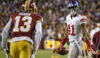 New York Giants cornerback Dominique Rodgers-Cromartie (41) looks at Washington Redskins wide receiver Maurice Harris (13) after intercepting a pass intended for Harris during the second half of an NFL football game in Landover, Md., Sunday, Jan. 1, 2017. (AP Photo/Nick Wass)