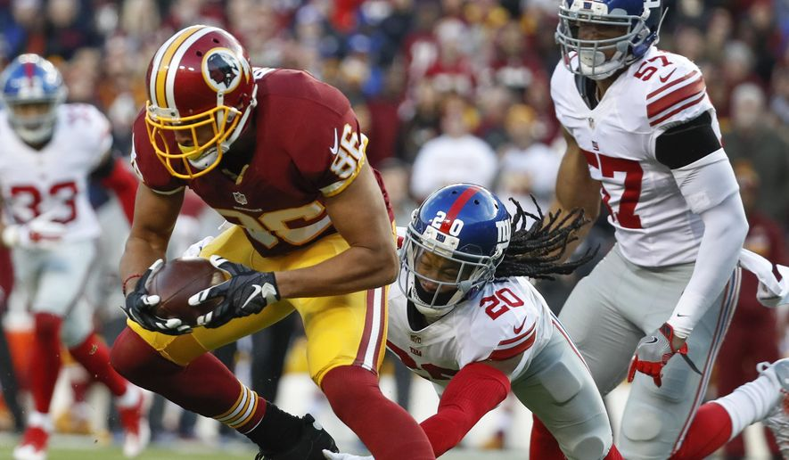 Washington Redskins tight end Jordan Reed (86) breaks a tackle attempt by New York Giants cornerback Janoris Jenkins (20) during the first half of an NFL football game in Landover, Md., Sunday, Jan. 1, 2017. (AP Photo/Alex Brandon) **FILE**