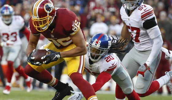 Washington Redskins tight end Jordan Reed (86) breaks a tackle attempt by New York Giants cornerback Janoris Jenkins (20) during the first half of an NFL football game in Landover, Md., Sunday, Jan. 1, 2017. (AP Photo/Alex Brandon)