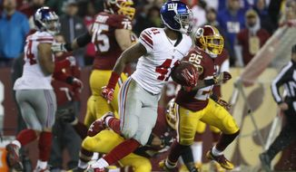 New York Giants cornerback Dominique Rodgers-Cromartie (41) carries the ball after intercepting a pass intended for Washington Redskins wide receiver Pierre Garcon (88) during the second half of an NFL football game in Landover, Md., Sunday, Jan. 1, 2017. The Giants won 19-10. (AP Photo/Alex Brandon)