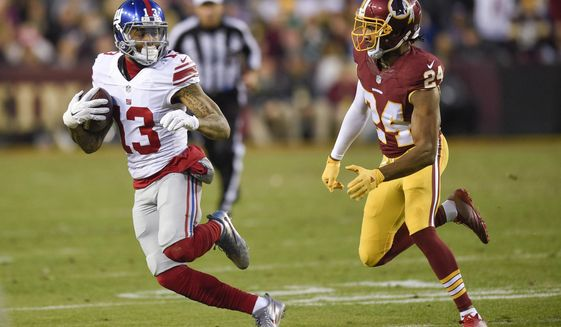 New York Giants wide receiver Odell Beckham (13) looks over his shoulder at Washington Redskins cornerback Josh Norman (24) during the first half of an NFL football game in Landover, Md., Sunday, Jan. 1, 2017. (AP Photo/Nick Wass)