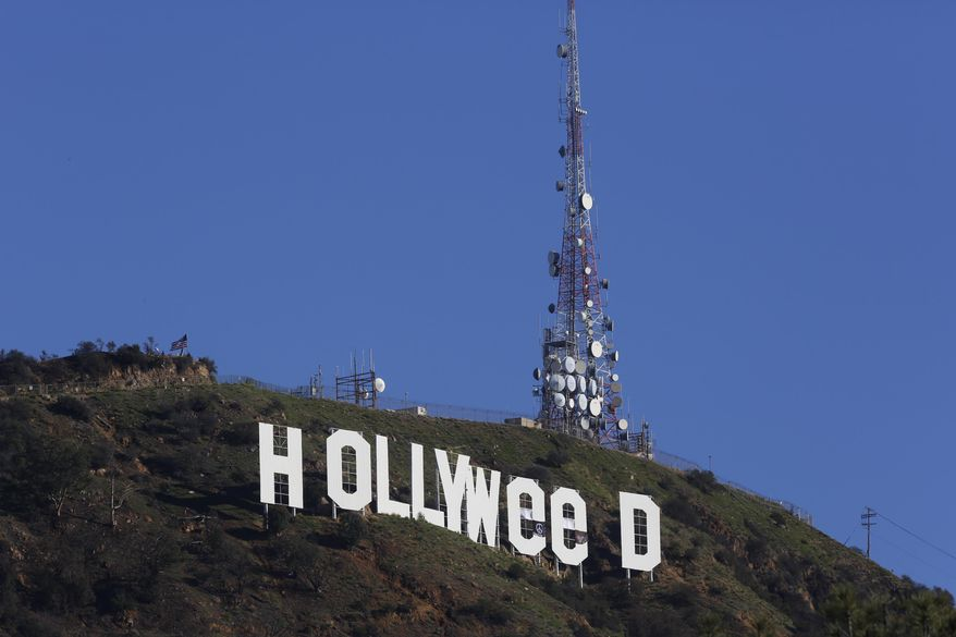 """The Hollywood sign is seen vandalized Sunday, Jan. 1, 2017. Los Angeles residents awoke New Year's Day to find a prankster had altered the famed Hollywood sign to read """"HOLLYWeeD."""" Police have notified the city's Department of General Services, whose officers patrol Griffith Park and the area of the rugged Hollywood Hills near the sign. California voters in November approved Proposition 64, which legalized the recreational use of marijuana, beginning in 2018. (AP Photo/Damian Dovarganes)"""