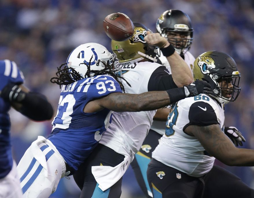 Indianapolis Colts linebacker Erik Walden (93) forces a fumble as he sacks Jacksonville Jaguars quarterback Blake Bortles (5) during the first half of an NFL football game in Indianapolis, Sunday, Jan. 1, 2017. The Colts recovered the fumble. (AP Photo/AJ Mast)
