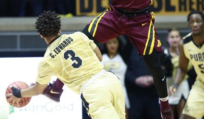 Minnesota guard Nick Mason (2) defends against Purdue guard Carsen Edwards (3) in the first half of an NCAA college basketball game, Sunday, Jan. 1, 2017, in West Lafayette, Ind. (AP Photo/R Brent Smith)