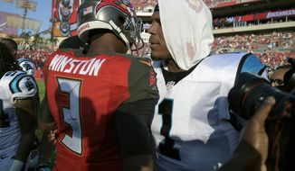 Carolina Panthers quarterback Cam Newton (1) congratulates Tampa Bay Buccaneers quarterback Jameis Winston (3) after the Buccaneers defeated the Panthers 17-16 during an NFL football game Sunday, Jan. 1, 2017, in Tampa, Fla. (AP Photo/Phelan M. Ebenhack)