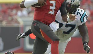 Tampa Bay Buccaneers quarterback Jameis Winston (3) eludes Carolina Panthers defensive tackle Kyle Love (77) on a run during the first quarter of an NFL football game Sunday, Jan. 1, 2017, in Tampa, Fla. (AP Photo/Phelan Ebenhack)