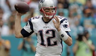 New England Patriots quarterback Tom Brady (12) looks to pass, during the first half of an NFL football game against the Miami Dolphins, Sunday, Jan. 1, 2017, in Miami Gardens, Fla. (AP Photo/Alan Diaz)