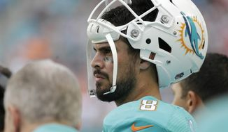 Miami Dolphins quarterback Matt Moore (8) looks out on the field, during the second half of an NFL football game, Sunday, Jan. 1, 2017, in Miami Gardens, Fla. The Patriots defeated the Dolphins 35-14. (AP Photo/Lynne Sladky)