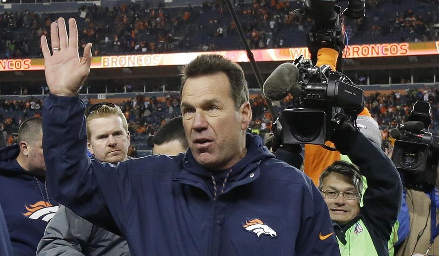 Denver Broncos coach Gary Kubiak waves as he walks off the field after the team's NFL football game against the Oakland Raiders, Sunday, Jan. 1, 2017, in Denver. The Broncos won 24-6. (AP Photo/Jack Dempsey)