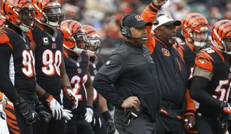 Cincinnati Bengals head coach Marvin Lewis, center right, works the sideline in the first half of an NFL football game against the Baltimore Ravens, Sunday, Jan. 1, 2017, in Cincinnati. (AP Photo/Frank Victores)