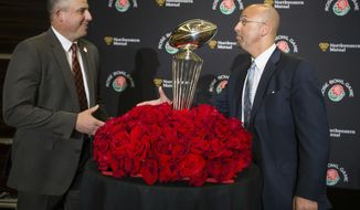 Penn State head coach James Franklin, right, greets Southern California head coach Clay Helton during an NCAA college football news confernce for the Rose Bowl, Saturday, Dec. 31, 2016,  in Los Angeles. The Nittany Lions will take on USC on Monday, Jan. 2. (Joe Hermitt/PennLive.com via AP)