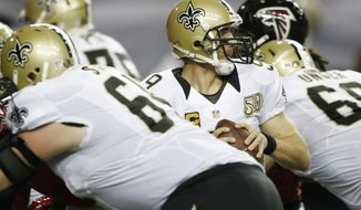 New Orleans Saints quarterback Drew Brees (9) moves into the pocket against the Atlanta Falcons during the first half of an NFL football game, Sunday, Jan. 1, 2017, in Atlanta. (AP Photo/John Bazemore)