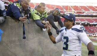 Seattle Seahawks quarterback Russell Wilson (3) greets fans after an NFL football game against the San Francisco 49ers in Santa Clara, Calif., Sunday, Jan. 1, 2017. (AP Photo/Tony Avelar)