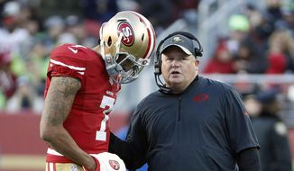 San Francisco 49ers quarterback Colin Kaepernick (7) talks with head coach Chip Kelly during the second half of an NFL football game against the Seattle Seahawks in Santa Clara, Calif., Sunday, Jan. 1, 2017. (AP Photo/Tony Avelar)