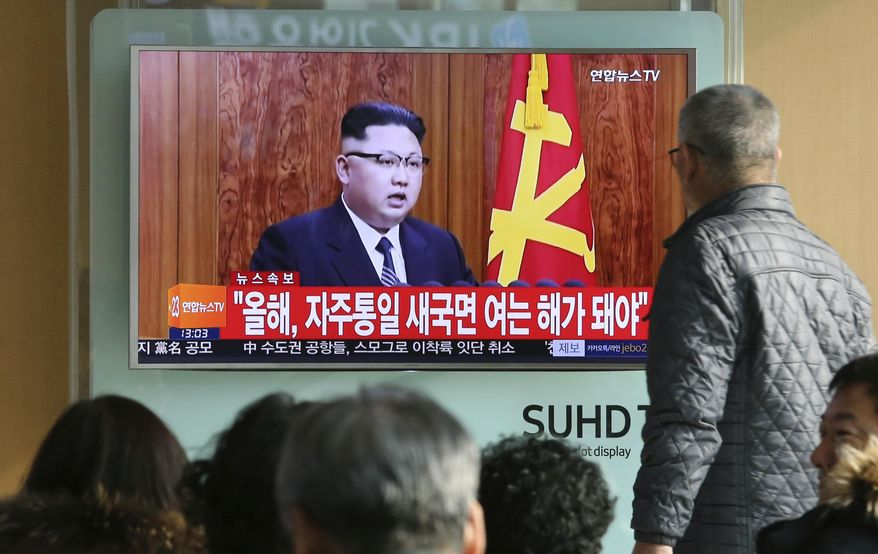 """South Koreans watch a TV news program showing North Korean leader Kim Jong Un's New Year's speech, at the Seoul Railway Station in Seoul, South Korea, Sunday, Jan. 1, 2017. North Korea's development of banned long-range missiles is in """"final stages,"""" the country's leader Kim was quoted as saying in his New Year's message. The letters read """"New Year for Reunification."""" (AP Photo/Ahn Young-joon)"""