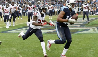 Tennessee Titans wide receiver Rishard Matthews (18) catches a 2-yard touchdown pass ahead of Houston Texans defensive back Robert Nelson (32) in the first half of an NFL football game Sunday, Jan. 1, 2017, in Nashville, Tenn. (AP Photo/Mark Zaleski)