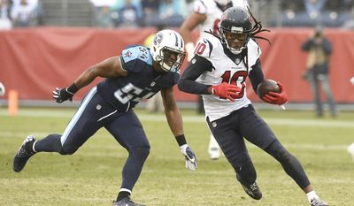 Houston Texans wide receiver DeAndre Hopkins (10) gets past Tennessee Titans linebacker Avery Williamson (54) in the second half of an NFL football game Sunday, Jan. 1, 2017, in Nashville, Tenn. (AP Photo/Mark Zaleski)