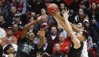 From left to right, Cincinnati's Jacob Evans, Tulane's Melvin Frazier (35), Tulane's Sammis Reyes and Cincinnati's Jarron Cumberland (34) battle for a rebound in the first half of an NCAA college basketball game, Sunday, Jan. 1, 2017, in Cincinnati. (AP Photo/John Minchillo) **FILE**