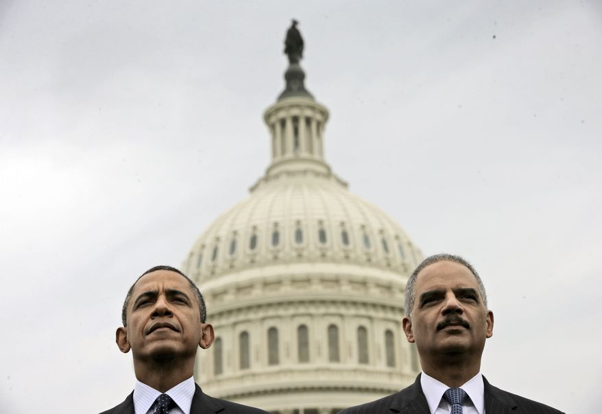 In this May 15, 2013, photo, President Barack Obama sits with Attorney General Eric Holder during the 32nd annual the National Peace Officers Memorial Service on Capitol Hill in Washington. (AP Photo/Pablo Martinez Monsivais) **FILE**