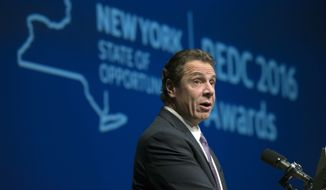FILE - In this Thursday, Dec. 8, 2016, file photo, New York Gov. Andrew Cuomo speaks during an economic development awards ceremony in Albany, N.Y.  Cuomo has vetoed a proposal to make the state pay for public defenders. His decision means that at least for now, individual counties will largely keep footing the bill for defending poor people accused of crimes. Supporters said the legislation would have helped ensure New Yorkers have equal access to justice. But the Democratic governor said it went too far and included hundreds of millions of dollars for legal services in family court and other settings. (AP Photo/Mike Groll, File)