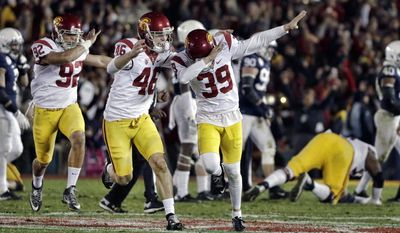 Southern California place kicker Matt Boermeester celebrates after kicking the game winning field goal against Penn State during the second half of the Rose Bowl NCAA college football game Monday, Jan. 2, 2017, in Pasadena, Calif. (AP Photo/Gregory Bull)