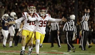 Southern California place kicker Matt Boermeester, right, celebrates after the game winning field goal against Penn State during the second half of the Rose Bowl NCAA college football game Monday, Jan. 2, 2017, in Pasadena, Calif. (AP Photo/Gregory Bull)